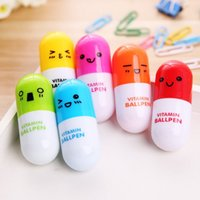 Wholesale-12Pcs / set Cute Smile Face Vitamine Pill Ball Pen Ballpoint BallPen Birthday Party Cadeaux pour enfants Jouets pour enfants WD126AA