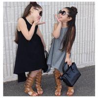 color negro chalecos chicas al por mayor-Vestido asimétrico de la moda de las muchachas Vestido sin mangas de algodón del color sólido vestido negro gris 2colors poco outsetters de la ropa para 1-3T