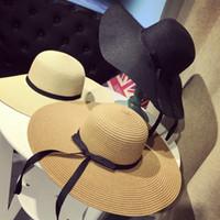 amplio sombrero de playa floppy al por mayor-Mujeres grande Floppy plegable sombrero de paja Boho Wide Brim Beach Sun Cap 3 colores con arco vacaciones de verano envío gratis