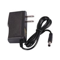 разъемы штекеры сетевой адаптер оптовых-универсальный импульсный источник питания переменного тока 12 В 1A 1000 мА адаптер ЕС / США штекер 5,5 * 2,1 мм разъем