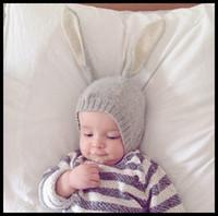bebek kızları siyah şapka toptan satış-Bebek Paskalya Tavşan Bere örgü Şapka Güzel Bunny Kış sıcak Kulakları Korumak bebekler Kız Erkek Şapka Toptan 2017 Siyah gri 0-12months