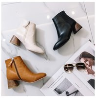 Wholesale New Products Grains - In the autumn of 2017, the European and American new products will be made of pure white round boots with high heels and zipper boots