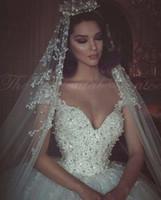 Wholesale crystal brides dress dubai resale online - Luxury Ball Gown Princess Wedding Dresses Pearls Beads Lace Applique Off Shoulder Arabic Bride Dresses in Dubai Wedding Gowns