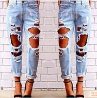 jeans de mujer destruidos al por mayor-Ripped Jeans Denim Joggers Agujeros de rodilla Slim Fit Jeans Para mujeres Blue Rock Star Jumpsuit para mujer Jeans destruidos Boyfriend Lápiz pantalones
