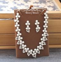gelin yüzükleri toptan satış-Yeni Zarif Düğün Gelin Takı Gümüş Fildişi İnciler ile Rhinestones Güzel Kolye ile Kulak Yüzükler Kızlar Balo Parti Aksesuar