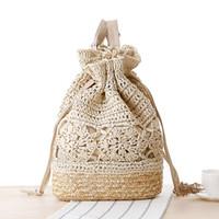 ingrosso sacchetti di pizzo fatti a mano-2017 Estate Drawstring Lace Crochet Straw Beach Bags Designer di alta qualità femminile scava fuori fiore zaino lavorato a maglia a mano