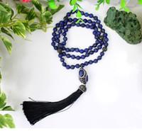 perles de lapis ovales achat en gros de-Longues perles de pierre naturelle en lapis-lazuli de 8 mm et quatre perles intercalaires en strass avec pendentif gland en polyester avec pierre ovale