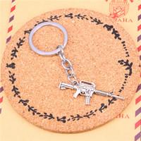 Wholesale Wholesale Assault Rifles - Car Key Ring Pendant Silver Color Metal Key Chains Accessory Wholesale ,Vintage machine gun assault rifle Keychain