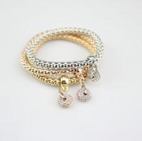 ingrosso catena shambhala-Set di 3 pezzi Set di bracciali con catena di mais Set di anelli di Shambhala con strass multistrato oro / argento / placcato in oro rosetta
