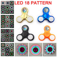 Wholesale light up spin top - LED Light Up Triangle Fidget Spinner 11 LED Beads 18 Patterns Replaceable Battery finger spinning top EDS hand Spinners Toys in retail box