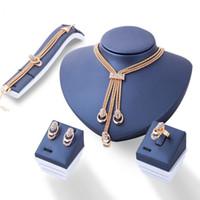 amethyst grau perlenarmbänder großhandel-Europäische und amerikanische mode frauen hochzeit kristall ohrringe bracele tring halsketten braut vier sätze schmuck zubehör