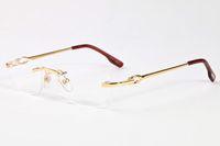 lunettes de bison achat en gros de-2017 Rimless clair lentille lunettes hommes buffle corne lunettes de soleil femmes cadres or argent alliage métal cadre lunettes gafas 52-18-140mm