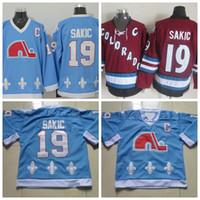 nordiques jersey vintage al por mayor-Mens Quebec Nordiques Hockey Jerseys 19 Joe Sakic bebé azul Jersey cosida avalancha de Colorado Vintage CCM Borgoña camisas C Patch