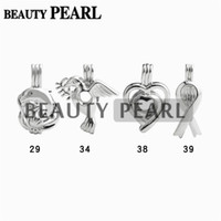 Wholesale piece dove - 10 Pieces Wholesale Love Pearl Pendant Cage Different Designs Dolphin Peace Dove Heart Ribbon Wish Cages Jewelry