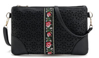 фирменная цветочная сумочка оптом оптовых-Оптовая продажа-новый сезон женщина этнический крест сумка выдалбливают цветочные сумка леди черная сумка дизайнер новый сумочка весна сцепления