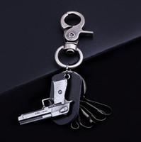 metal anahtarlık tasarımları toptan satış-Retro Tasarım Hakiki Deri Anahtarlık Alaşım Gun Kolye Anahtarlıklar Lüks Erkekler Hediyeler Moda Araba Anahtarlık