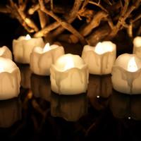 ingrosso candele elettroniche tremolanti-Candele senza fiamma tremolanti bianche calde con le candele elettroniche del tè delle luci del tè a pile LED della candela della festa nuziale di Natale del temporizzatore