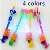 parapluies volants achat en gros de-Enfants jouets LED Flying Toy parapluie Arrow Meteor douche émettant de la lumière libellule catapulte slingshot avion flash cadeau pour enfants B0044