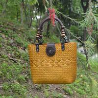 thai fabrik großhandel-Fabrik Direktverkauf von 17 Thai-Version der Hand-Stroh-verpackt Frauen Stil Retro-Mode Rattan Gras Handtasche Tourismus Resort Strand Pack