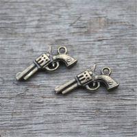 amuletos antiguos al por mayor-25pcs - Gun Charms, Pistolas 3D de Bronce Antiguo Pistolas Pistolas Colgantes Charms 21x11mm