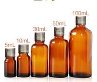 ingrosso tappo bottiglia olio essenziale-5ml 10ml 30ml 50ml 100ml Brown Essential Oil Bottle Bottiglia vuota in vetro color ambra con coperchio e tappo in argento