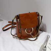 Wholesale The European metal ring genuine leather women s bag with a single shoulder bag fashion student package