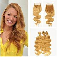 en iyi sarışın uzantılar toptan satış-Kapatma Ile vücut Dalga İnsan Saç Atkı Bal Sarışın # 27 Çilek Sarışın Saç Uzantıları Ile 4 * 4 Dantel Üst Kapatma