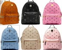 kore erkekleri için omuz çantaları toptan satış-Toptan Punk stil Perçin Sırt Çantası Moda Erkek Kadın Ucuz Sırt Çantası Kore Şık Omuz Çantası Marka Tasarımcı Çanta High-end PU Okul Çantası