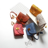 Wholesale European Phone - Famous designer brand new European and American candy color handbag chain hollow senior leather small square bag mobile phone bag wholesale