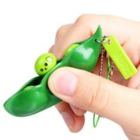 Wholesale Funny Extrusion Squeezed Bean Soybean Keychain Keyring Pop Up Pea Toys Gift For Baby Kids killing time