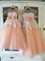 ingrosso nuovo vestito da cerimonia nuziale della pesca-2017 Nuovo arrivo Peach Flower Girl Dresses per Beach Wedding A-Line gioiello Illusion Bodice Ivory Lace Tulle abiti da sera prima comunione