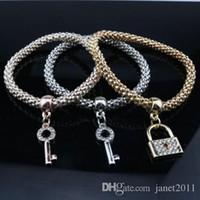 pulsera de cadena de diamantes de imitación al por mayor-Fashion Corn Chain Bracelets Three in one Oro / Plata / Oro rosa Rhinestone decorado Llave de la cerradura Estiramiento de la pulsera Conjunto de pulsera