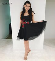 Vestidos de fiesta negro con flores rojas