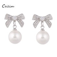 New Fashion Lovely Pearl Earring Bowknot Bow Earring Zircon CZ Stone Drop Dangle Earrings para mulheres Meninas Wedding Gift Jewelry