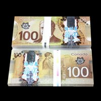 Wholesale Black People Videos - 100PCS Canada CAD100 TV Video Props Money Training Banknote Home Decoration Souvenir Arts and Crafts Gift Poker Game Chips Movie Props Money