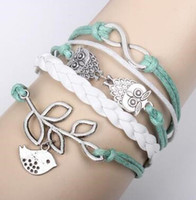 ingrosso cavi di bracciale in argento-Infinity Owls Lucky Branch Leaf e Lovely Bird Charm Bracelet in Silver Mint Green Wax Cords and Braid Wrap Wrap Christmas Gift