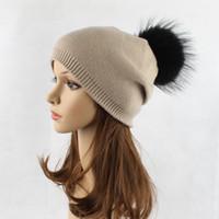 yüksek kaliteli saç boyası toptan satış-Yüksek kaliteli yün şapka bayanlar sonbahar ve kış boyama rakun kürk topu örgü şapka açık sıcak siyah saç topu kış şapka
