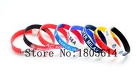 braceletes de futebol grátis venda por atacado-Calor! Equipe de futebol esportes pulseiras coloridas 100% silicone ginásio pulseira de fitness pode ser livre atacado 50 pcs entrega