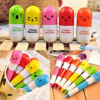 Cute Kawaii Smiling Face Pill Stylo à bille Plastique télescopique Creative Capsule Ballpen Office Fournitures scolaires Papeterie Kids Gift