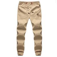 Wholesale mens bootcut - Wholesale- Plus 5XL Mens Joggers 2016 Brand Male Trousers Men Pants Casual Solid Pants Sweatpants Jogger khaki Black