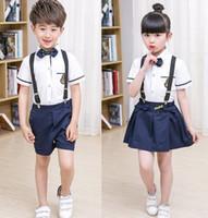 Wholesale School Uniform Dresses Bows - 2017 New Kids School Uniform Dress Set 2PCS Set Bow Tie Girl White T-shirt + Suspender Skirt Boys White Shirts+Suspender Short Pants B4603