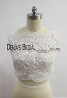 Wholesale Lace Bolero Button Back - 2017 Bridal Wedding Jacket or Wedding Bolero Bateau Neckline Beaded Lace Appliqued with Zipper Up Closure Back and Buttons Real Images
