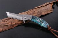 facas de bolso de damasco de ponta venda por atacado-High End 2 Estilo Damasco Flipper Faca Dobrável VG10 Damasco Aço Tanto Ponto Lâmina EDC Canivetes Com Bainha De Couro