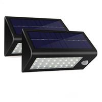 Wholesale Solar Motion Sensor Detector - Wholesale- 2pack lot 32 LED 550 Lumens Ultra Bright Outdoor Solar Powered Lamp Motion Sensor Wall Detector Light With 3 Modes Weatherproof