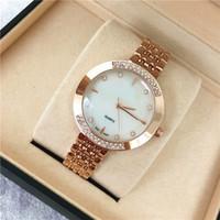 relojes populares al por mayor-Reloj de las mujeres populares de oro rosa de acero inoxidable señora reloj de pulsera de cuarzo diseñador de alta calidad relojes niñas regalos al por mayor Relogio masculino