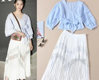 Wholesale Pleated Skirt Irregular - Star with the same section V-neck blue lace coat + lace fight pleated irregular half skirt sweet fresh suit female H0321