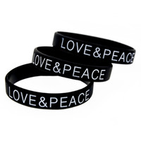 Wholesale silicone wristband printed logo - Drop Shipping 100PCS Lot Printed Logo Bracelet Love and Peace Silicone Wristband For Chrity Foundation Activity