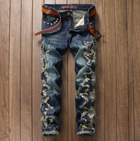 Wholesale european runway - 2018 New vintage Motorcycle Distrressed Ripped Jeans Hiphop Justin washed straight applique nailing Demin trousers Runway zipper fly pants