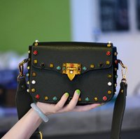 Wholesale Ms Wear - The new 2017 ms color rivet small bread worn across Europe and the United States the PU bag cover type woman messenger bag wide straps one s