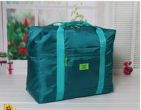 Wholesale 100pcs Travel Water Proof Unisex Travel Handbags more different color Women Luggage Travel Bag Folding Bags